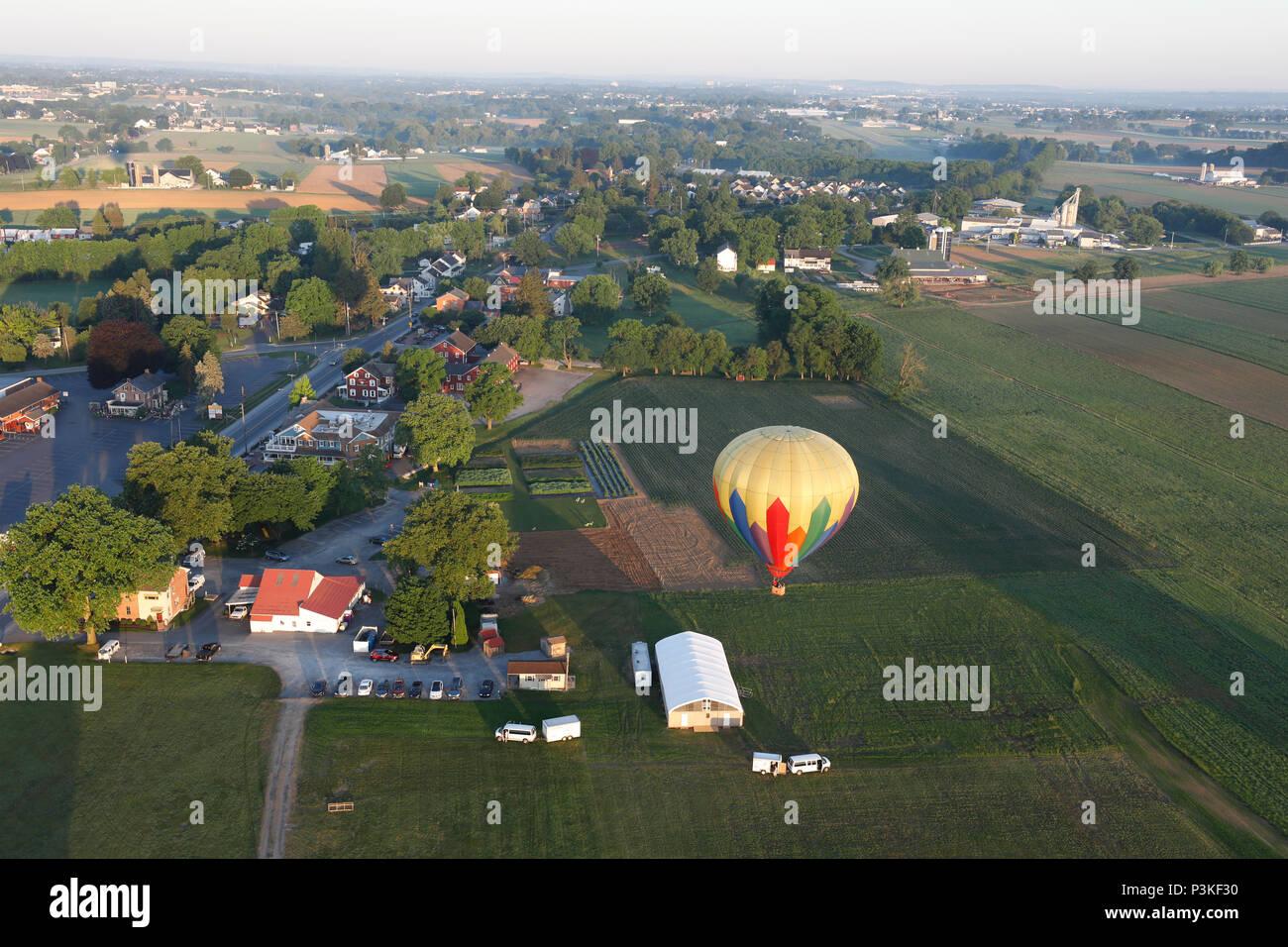 Aerial view of hot air balloon flying over farm, Lancaster County, Pennsylvania, USA Stock Photo