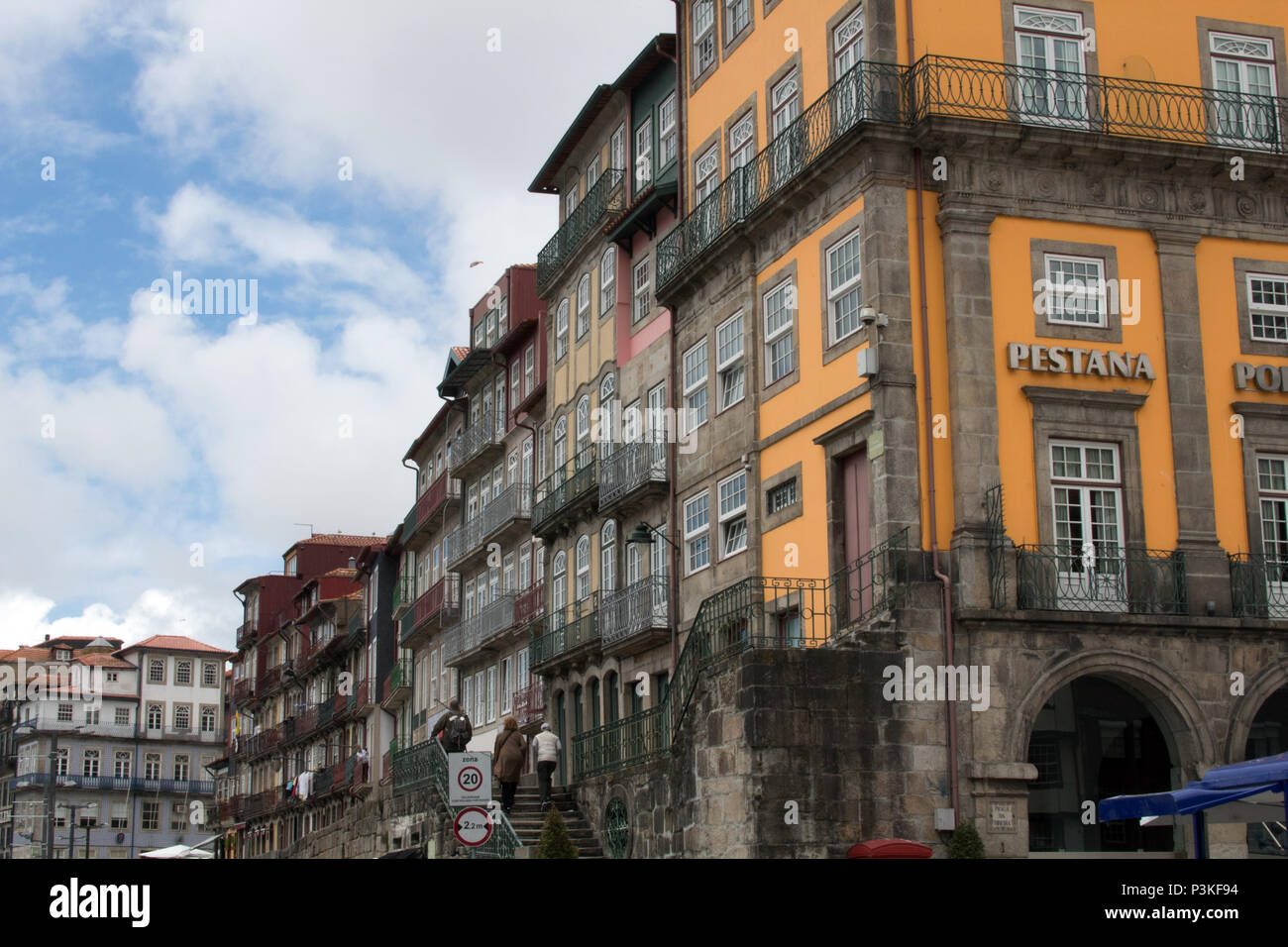 Colourful terraces of houses, bars and restaurants near the waterfront in the Ribeira district of Porto, Portugal - Stock Image