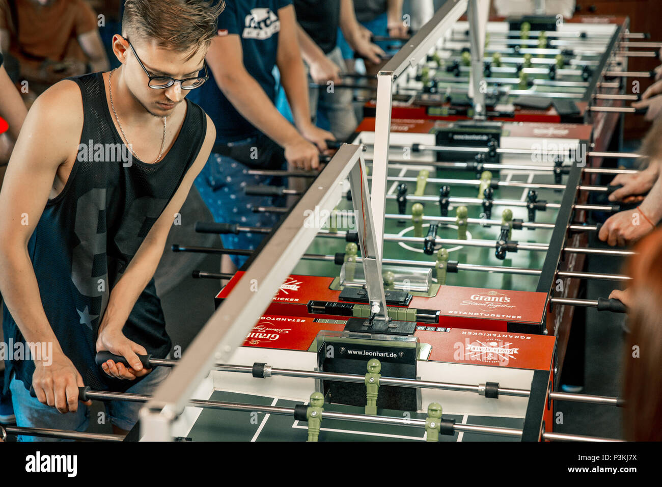 KYIV, UKRAINE, bar league of Grants KickerKicker 10 June 2018. Active men and women have fun during table soccer game. Competitions and qualifying rou - Stock Image