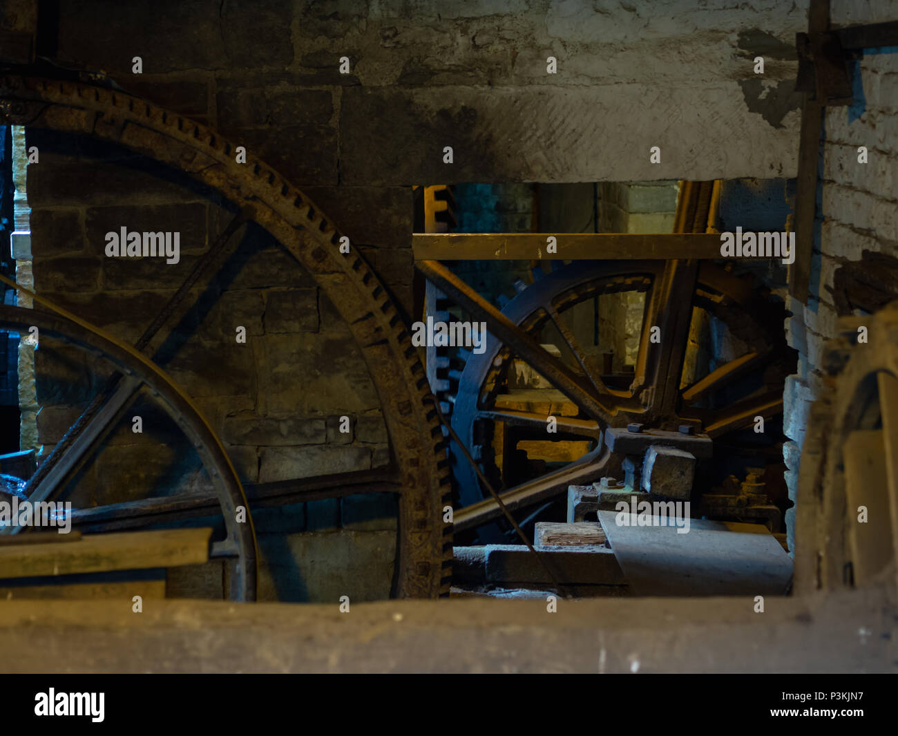 Rustic scene with giant cogwheels and gears - Stock Image
