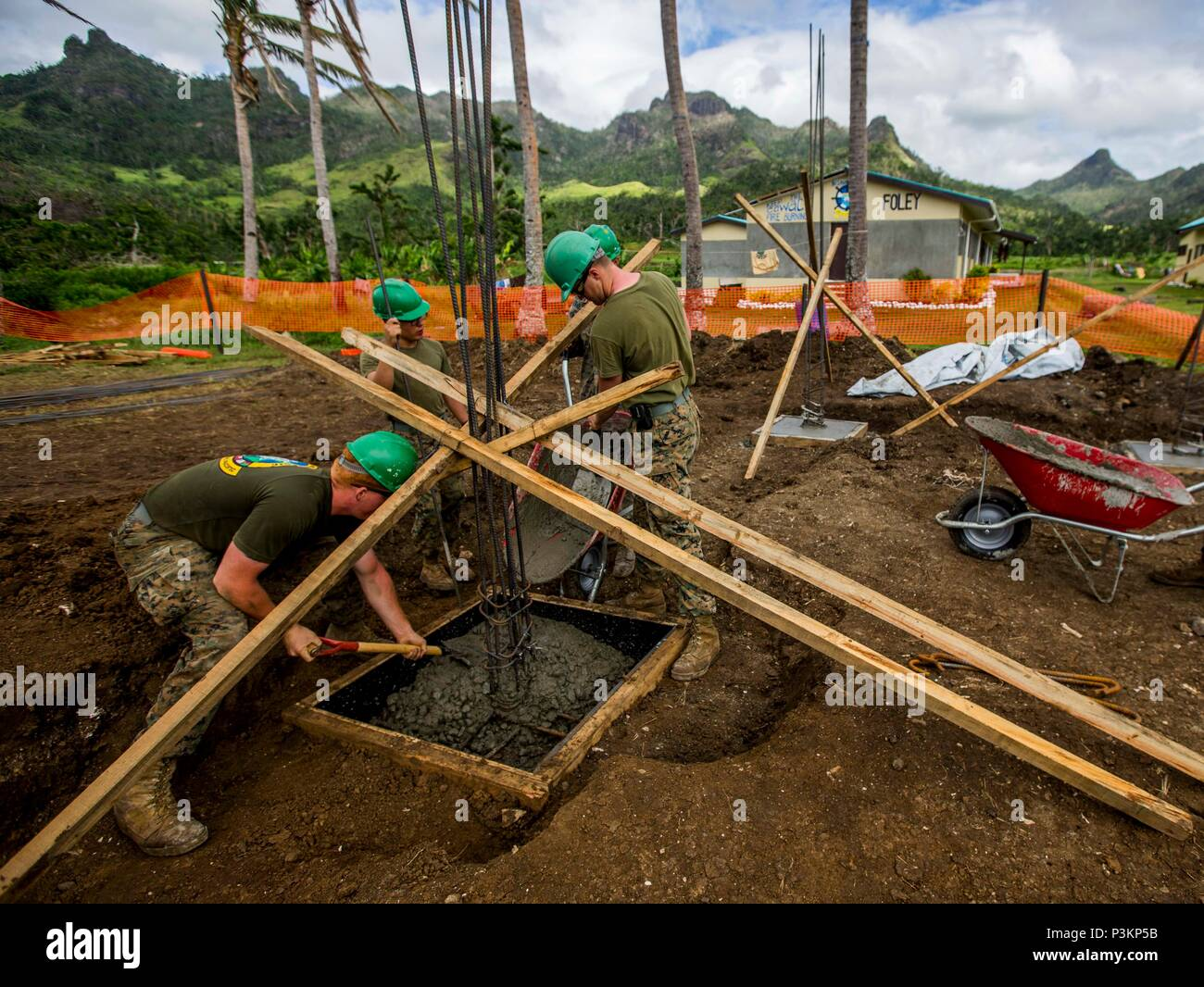 U.S. Marines and sailors with Task Force Koa Moana 16.2, conduct vertical construction training at St. John's College, Ovalau, Fiji, July 4, 2016.  Marines and Sailors with the task force will share engineering skills with Fijians to strengthen mil-to-mil relationships and interoperability. (U.S. Marine Corps imagery by MCIPAC Combat Camera Lance Cpl. Jesus McCloud/ Released) - Stock Image
