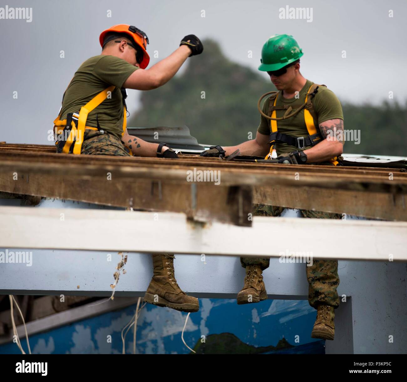 U.S. Marines Lance Cpl. Nathan D. Lyons and Cpl. Derek C. Brisendine, combat engineers with  Task Force Koa Moana 16.2, conduct vertical construction training at St. John's College, Ovalau, Fiji, July 4, 2016.  Marines and Sailors with the task force will share engineering skills with Fijians to strengthen mil-to-mil relationships and interoperability. (U.S. Marine Corps imagery by MCIPAC Combat Camera Lance Cpl. Jesus McCloud/ Released) - Stock Image