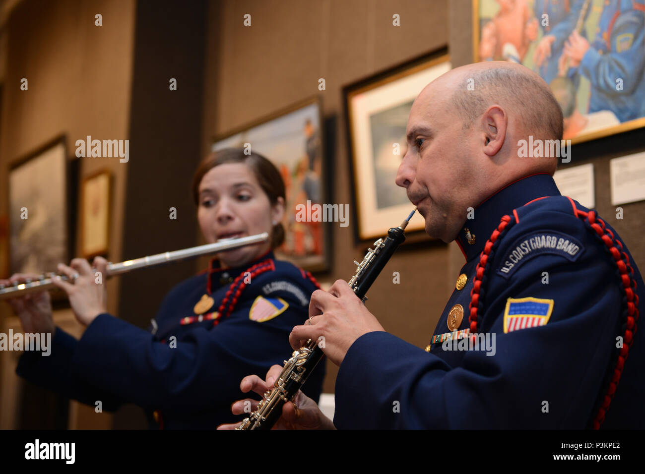 NEW YORK – Chief Petty Officer Barrett Seals and Petty Officer 1st Class Laurie Baynard, musicians in the Coast Guard Band play during the Coast Guard Art Program (COGAP) in New York City, July 5, 2016. The COGAP collection consists of nearly 2,000 pieces of works, which are primarily paintings. (Photo by Petty Officer 3rd Class Steve Strohmaier) Stock Photo