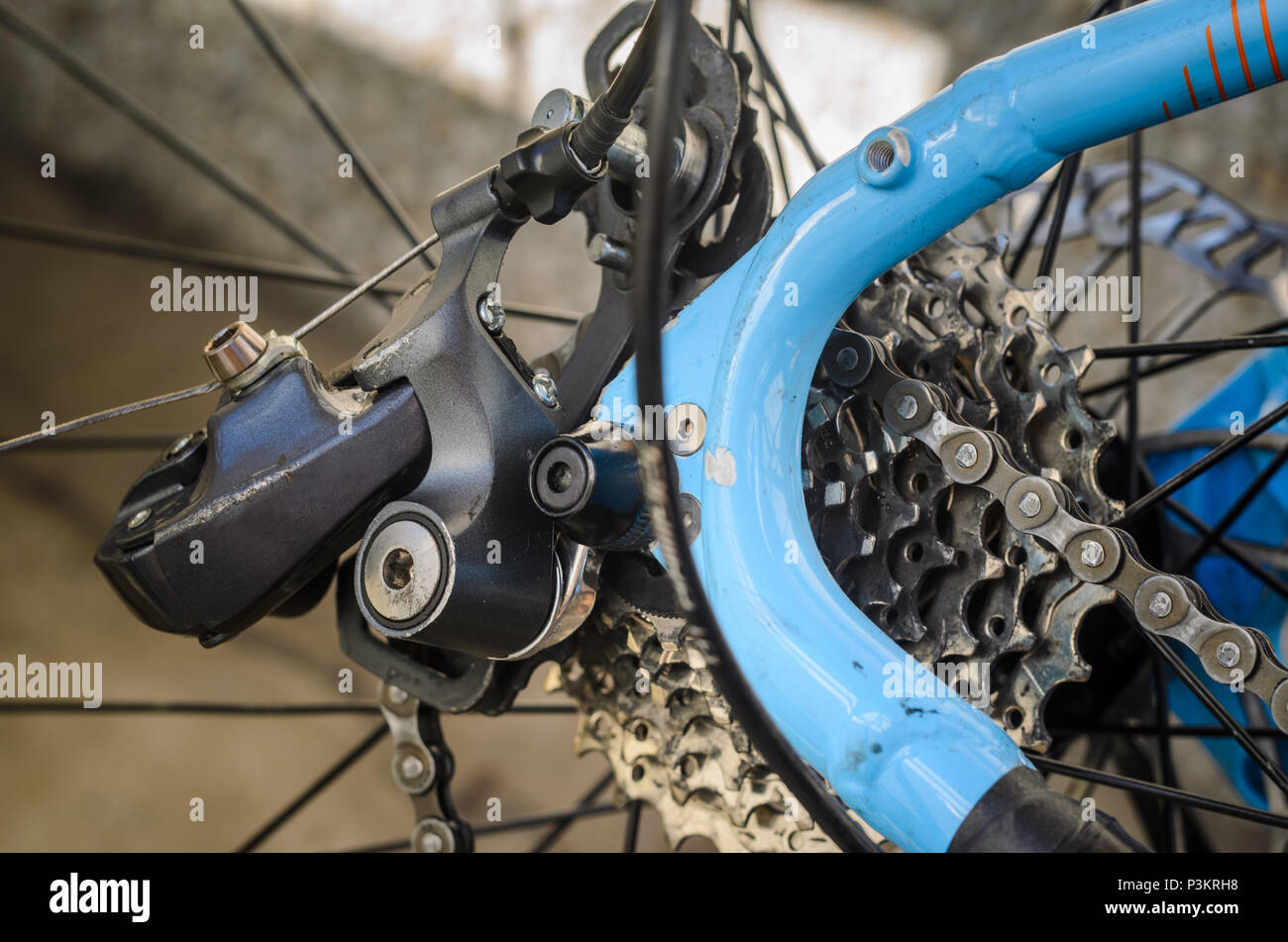 Rear Bicycle Derailleur Fell Apart in Half. Bicycle Rear Derailleur Foot is Detached from the Body. Unexpected Bike Failure. - Stock Image