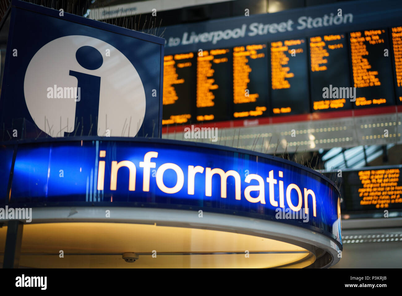 London, UK - November 2017. Information booth in Liverpool Street Station, one of the busiest train and underground stations in London. - Stock Image