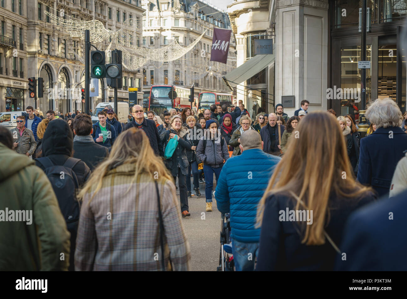 London, UK - November 2017. Decorated Regents Street crowded with people shopping for Christmas. Landscape format. Stock Photo
