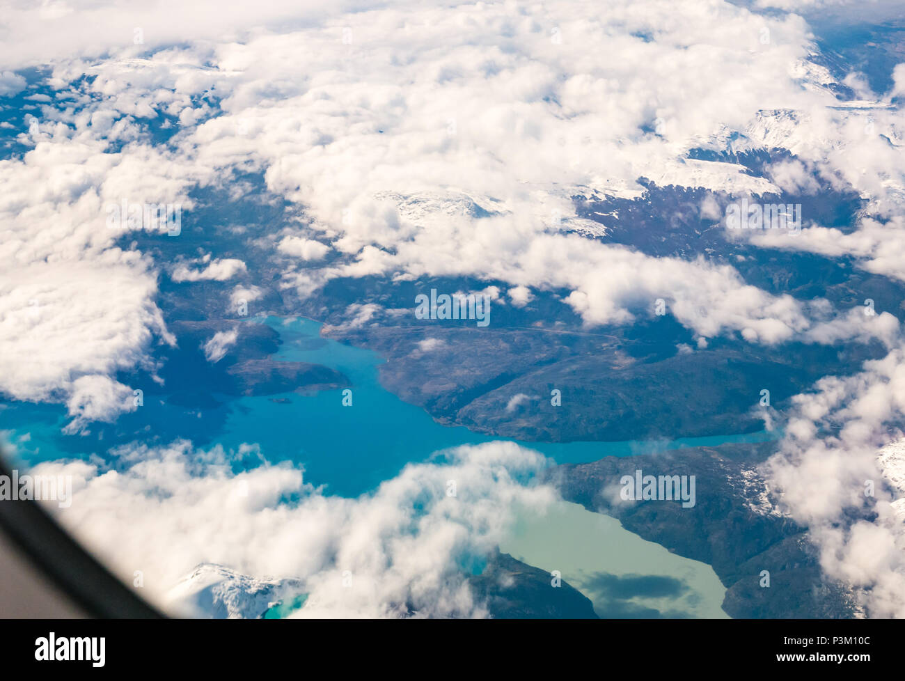 View from aeroplane window of snow covered Andes mountains with lakes of different colours, Southern Patagonian Ice field, Patagonia, Chile - Stock Image