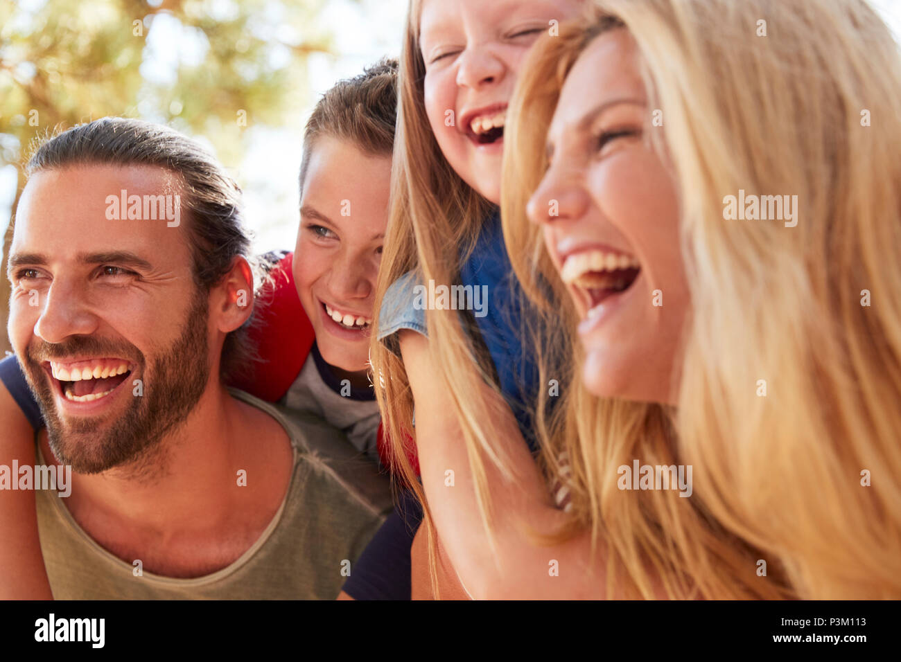 Head And Shoulders Shot Of Family On Hiking Adventure In Woods - Stock Image