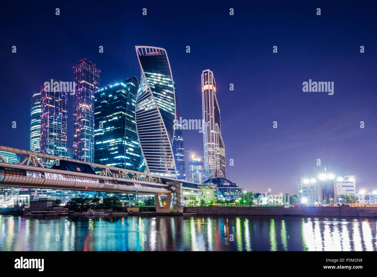 City of Moscow at night on the river with reflections in the illumination of skyscrapers - Stock Image
