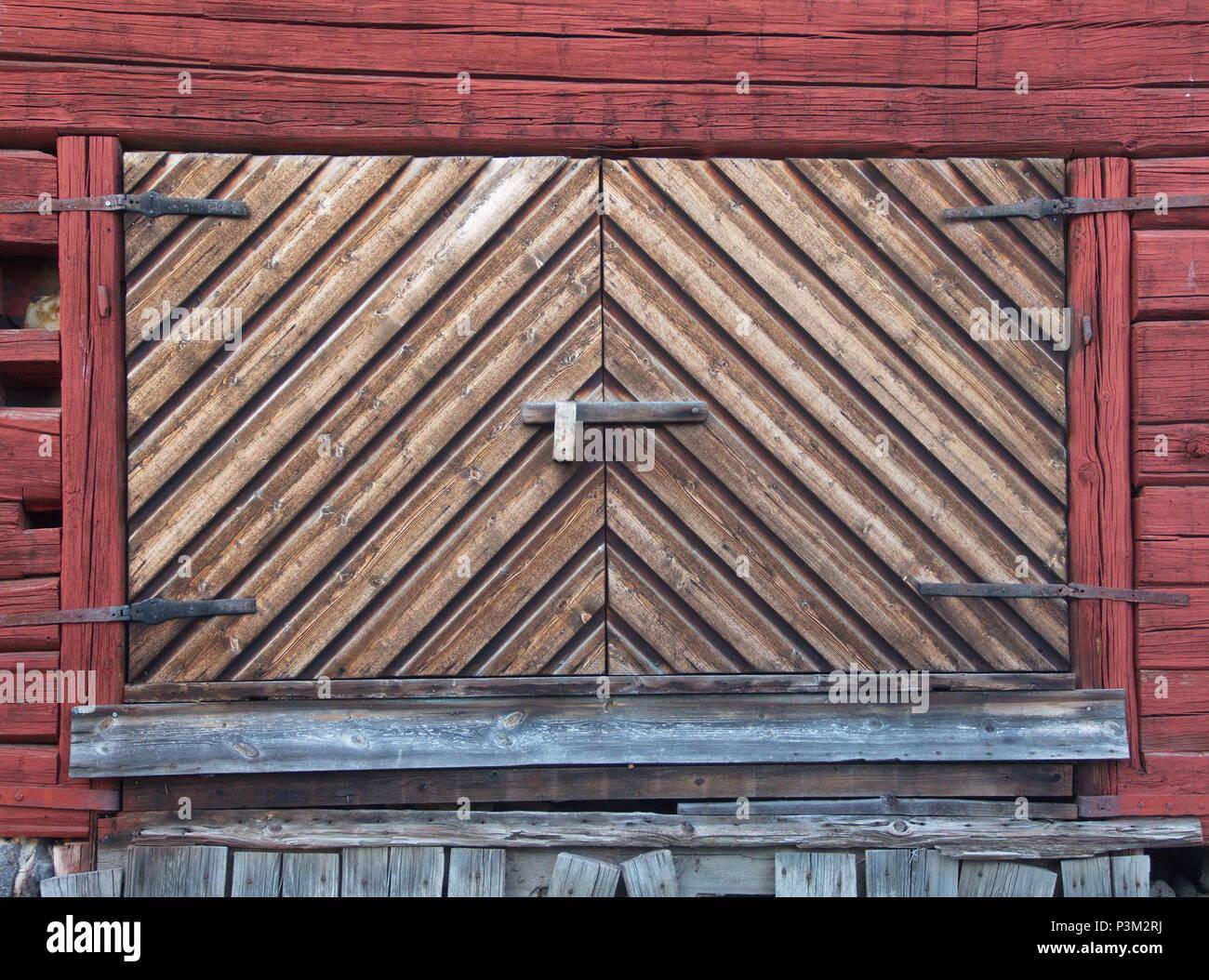 Old barn door in a swedish village - Stock Image