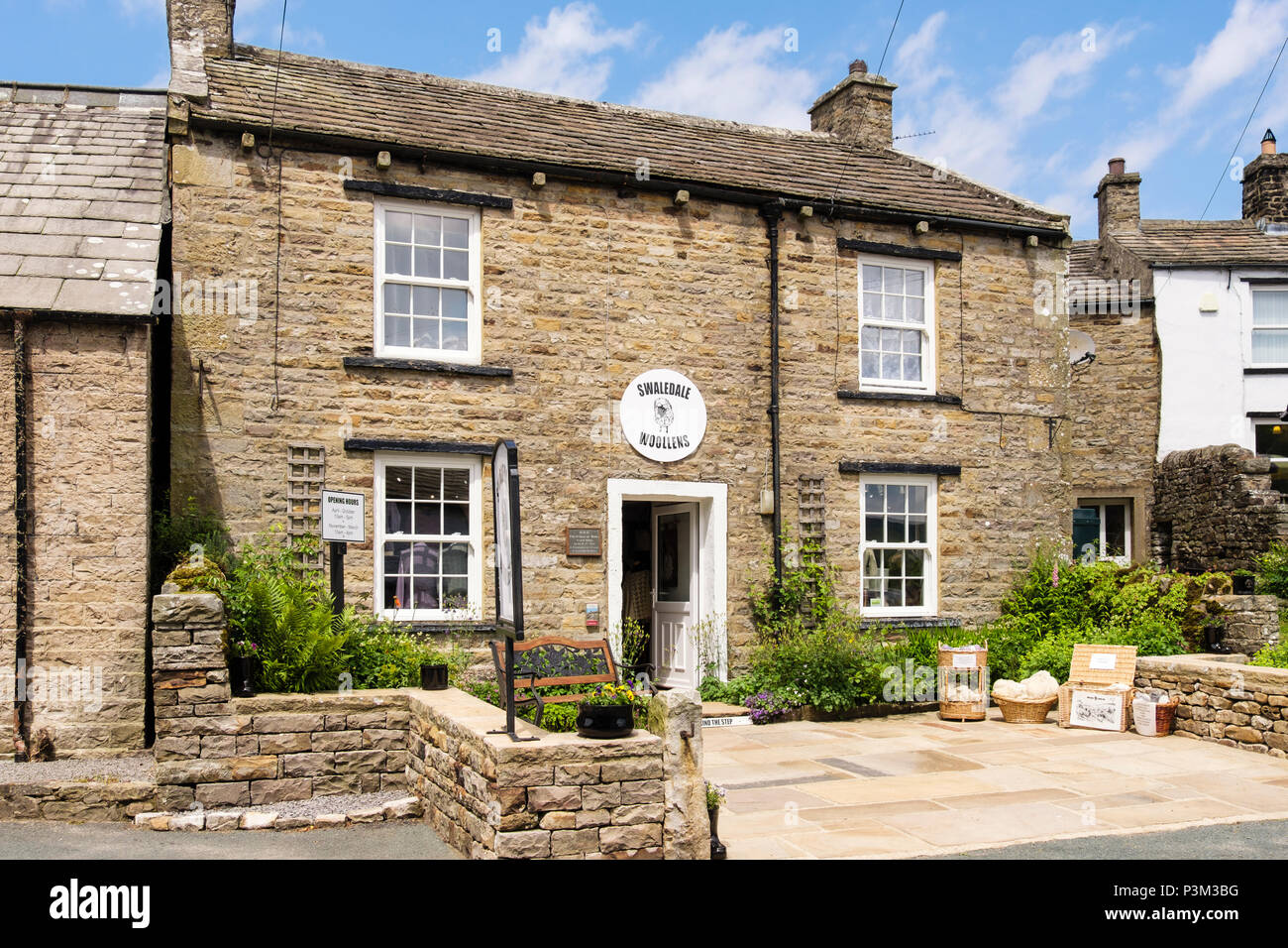 Swaledale Woollens shop in old traditional stone cottage. Muker, Swaledale, Yorkshire Dales National Park, North Yorkshire, England, UK, Britain - Stock Image