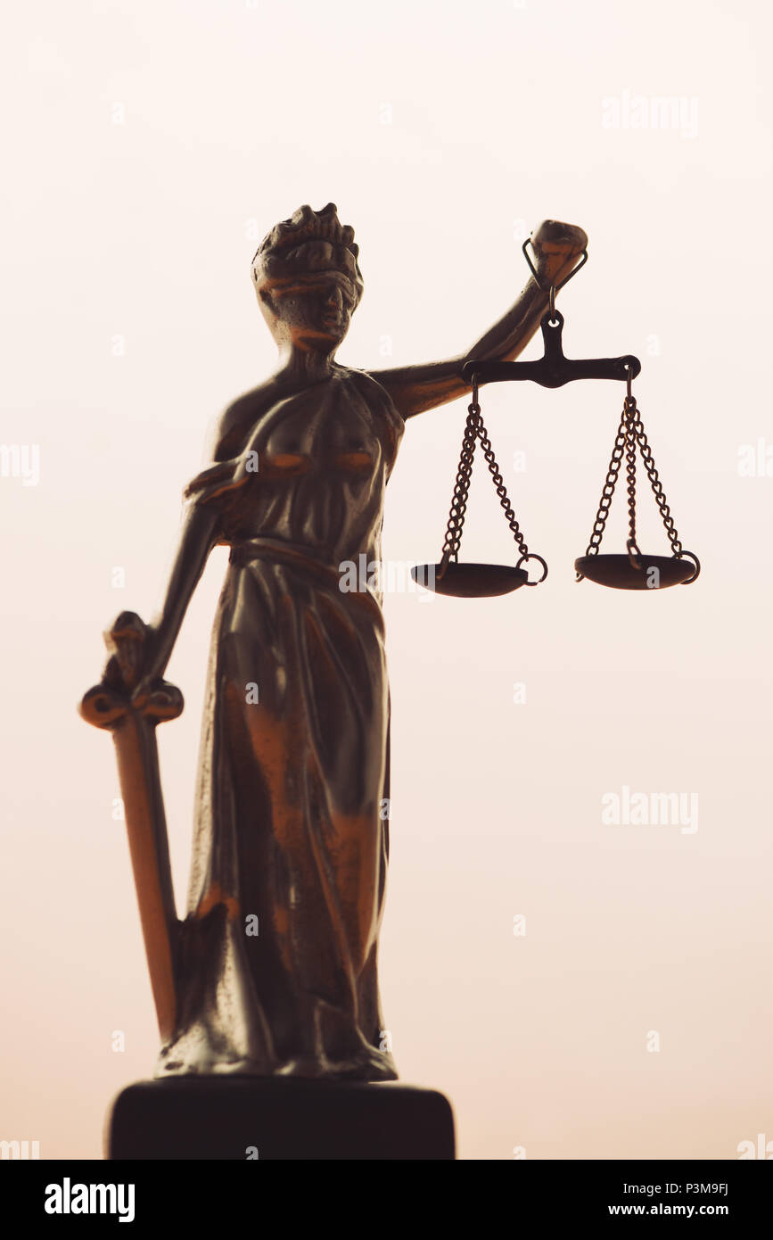 Statue of lady Justice or Justitia with scale on bright background - Stock Image