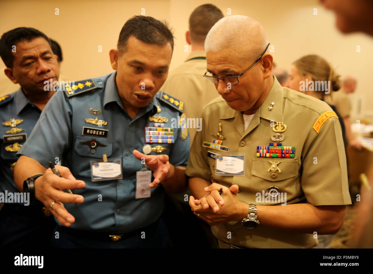SAN DIEGO, Calif. - Indonesian Commander Robert Marpaung, Staf Perwira Kerjasama Internasional V/ Strategi Operasi, Staf Operasi, Mabes TNI AL, and Major General Remigo Castro Valdez, commandant of the Philippine Marine Corps, interact with one another during a Table-Top Exercise, as part of Pacific Command Amphibious Leaders Symposium 2016 (PALS-16) in San Diego, Calif., July 12, 2016. PALS-16 brings together senior leaders of allied and partner nations throughout the Indo-Asia Pacific region. The symposium consists of academic and group discussions, a Table-Top Exercise and an amphibious lan Stock Photo