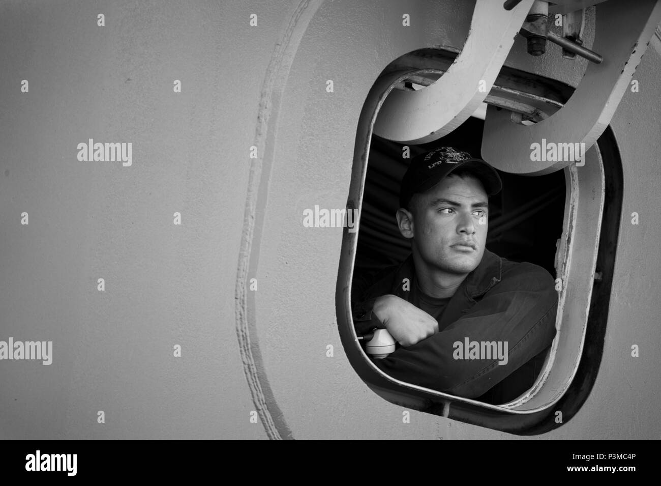 160711-N-KK330-376 JOINT BASE PEARL HARBOR-HICKAM (July 11, 2016) – Aviation Boatswain's Mate (Fuels) Airman Robert Getz, assigned to amphibious transport dock ship USS San Diego (LPD 22), looks out from his sea and anchor watch station prior to the ship departing Joint Base Pearl Harbor-Hickam during Rim of the Pacific 2016. Twenty-six nations, more than 40 ships and submarines, more than 200 aircraft, and 25,000 personnel are participating in RIMPAC from June 30 to Aug. 4, in and around the Hawaiian Islands and Southern California. The world's largest international maritime exercise, RIMPAC  - Stock Image