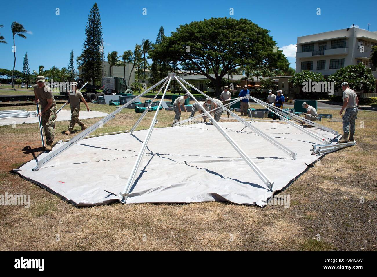 160712-N-SI773-143 FORD ISLAND, HAWAII (July 12, 2016) U.S. Army Soldiers assigned to 445th Civil Affairs Battalion setup a field hospital for Rim of the Pacific 2016. Twenty-six nations, more than 40 ships and submarines, more than 200 aircraft, and 25,000 personnel are participating in RIMPAC from June 30 to Aug. 4, in and around the Hawaiian Islands and Southern California. The world's largest international maritime exercise, RIMPAC provides a unique training opportunity that helps participants foster and sustain the cooperative relationships that are critical to ensuring the safety of sea  Stock Photo