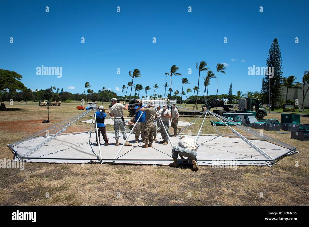 160712-N-SI773-157 FORD ISLAND, HAWAII (July 12, 2016) U.S. Army Soldiers assigned to 445th Civil Affairs Battalion setup a field hospital for Rim of the Pacific 2016. Twenty-six nations, more than 40 ships and submarines, more than 200 aircraft, and 25,000 personnel are participating in RIMPAC from June 30 to Aug. 4, in and around the Hawaiian Islands and Southern California. The world's largest international maritime exercise, RIMPAC provides a unique training opportunity that helps participants foster and sustain the cooperative relationships that are critical to ensuring the safety of sea  Stock Photo