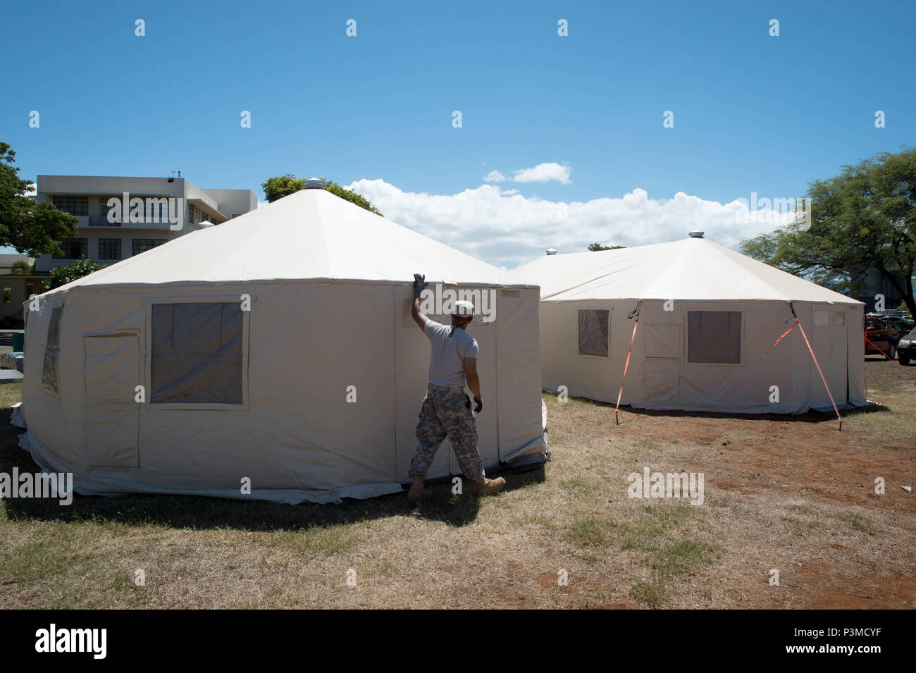 160712-N-SI773-258 FORD ISLAND, HAWAII (July 12, 2016) U.S. Army Soldiers assigned to 445th Civil Affairs Battalion setup a field hospital for Rim of the Pacific 2016. Twenty-six nations, more than 40 ships and submarines, more than 200 aircraft, and 25,000 personnel are participating in RIMPAC from June 30 to Aug. 4, in and around the Hawaiian Islands and Southern California. The world's largest international maritime exercise, RIMPAC provides a unique training opportunity that helps participants foster and sustain the cooperative relationships that are critical to ensuring the safety of sea  Stock Photo