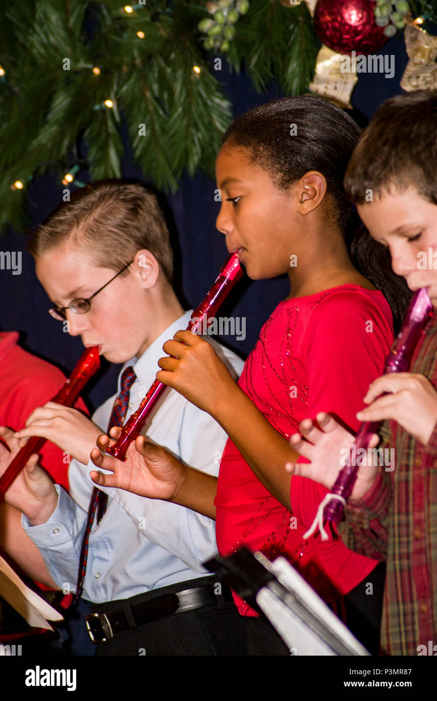 Tween years 9-10-11 year old children perform concert for parents and classmates in school  © Myrleen Pearson....Ferguson Cate - Stock Image