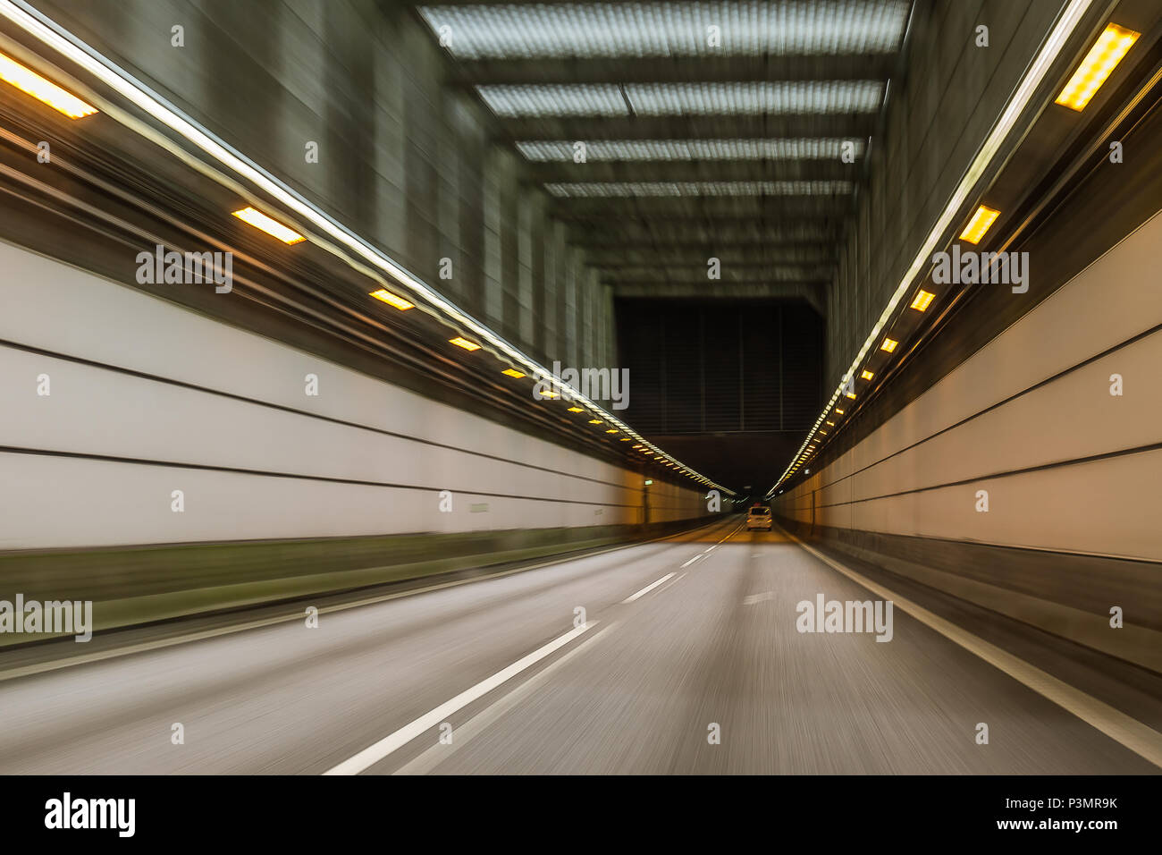 Driving a car through the tunnel between Denmark and Sweden, blurred motion. May 11. 2018 Stock Photo