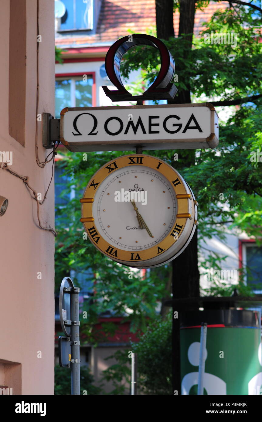 Wroclaw, Poland, Europe Large Omega watch clock timepiece shop sign logo - Stock Image