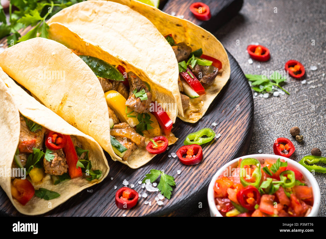 Mexican pork tacos with vegetables and salsa. - Stock Image