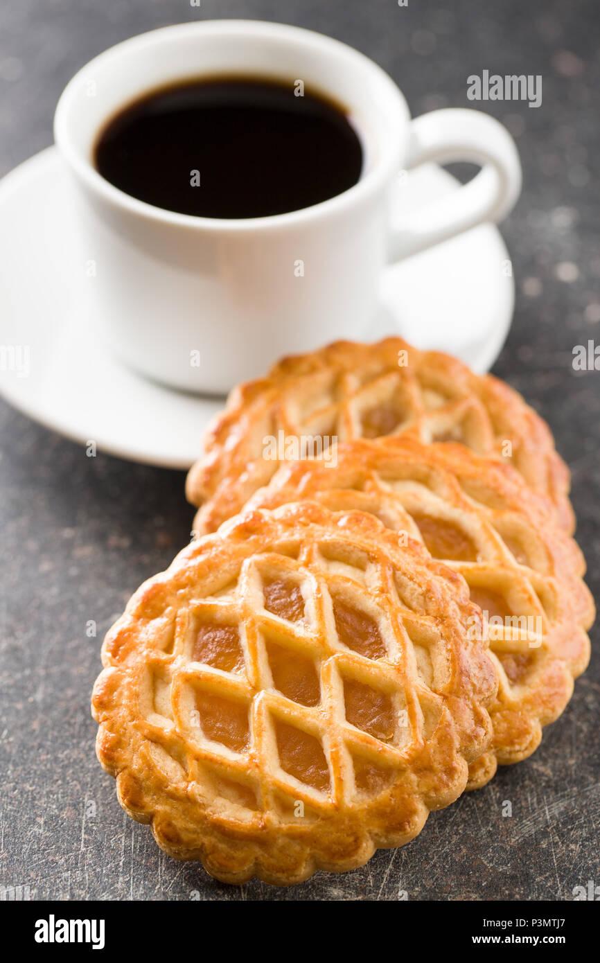 The apple pie cookies and coffee mug. - Stock Image