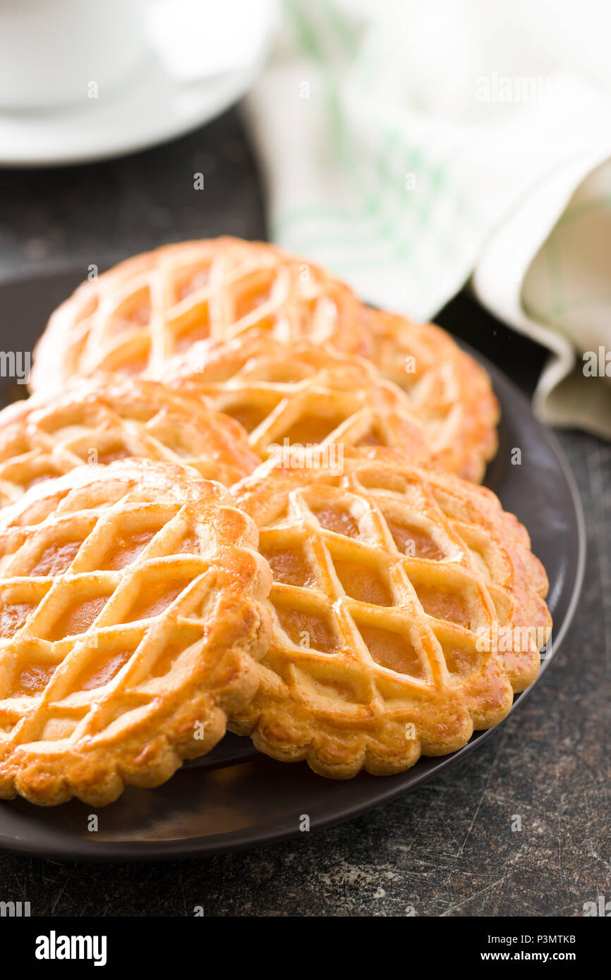 The apple pie cookies on old kitchen table. - Stock Image