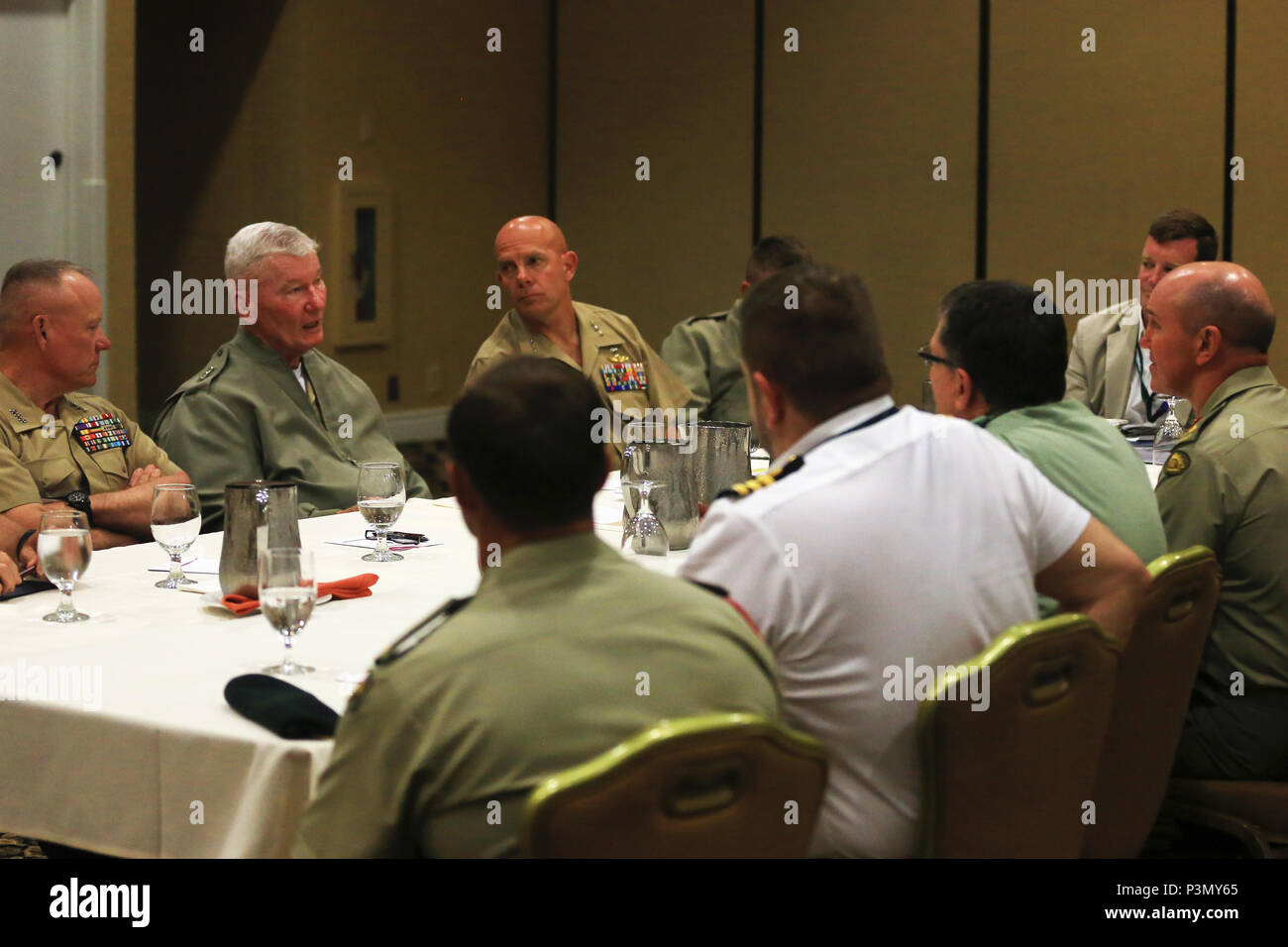 U.S. Marine Corps Lt. Gen. Lawrence Nicholson, left, commanding general, III Marine Expeditionary Force, Lt. Gen. John A. Toolan, middle, commanding general, Fleet Marine Force, Pacific, and Lt. Gen. David Berger, commanding general, I Marine Expeditionary Force, speak with representatives from New Zealand and Australia during the Pacific Command Amphibious Leaders Symposium 2016 (PALS-16) in San Diego, Calif., July 11, 2016. PALS-16 brings together senior leaders of allied and partner nations throughout the Indo-Asia Pacific region to have a meaningful dialogue on key aspects of maritime/amph Stock Photo