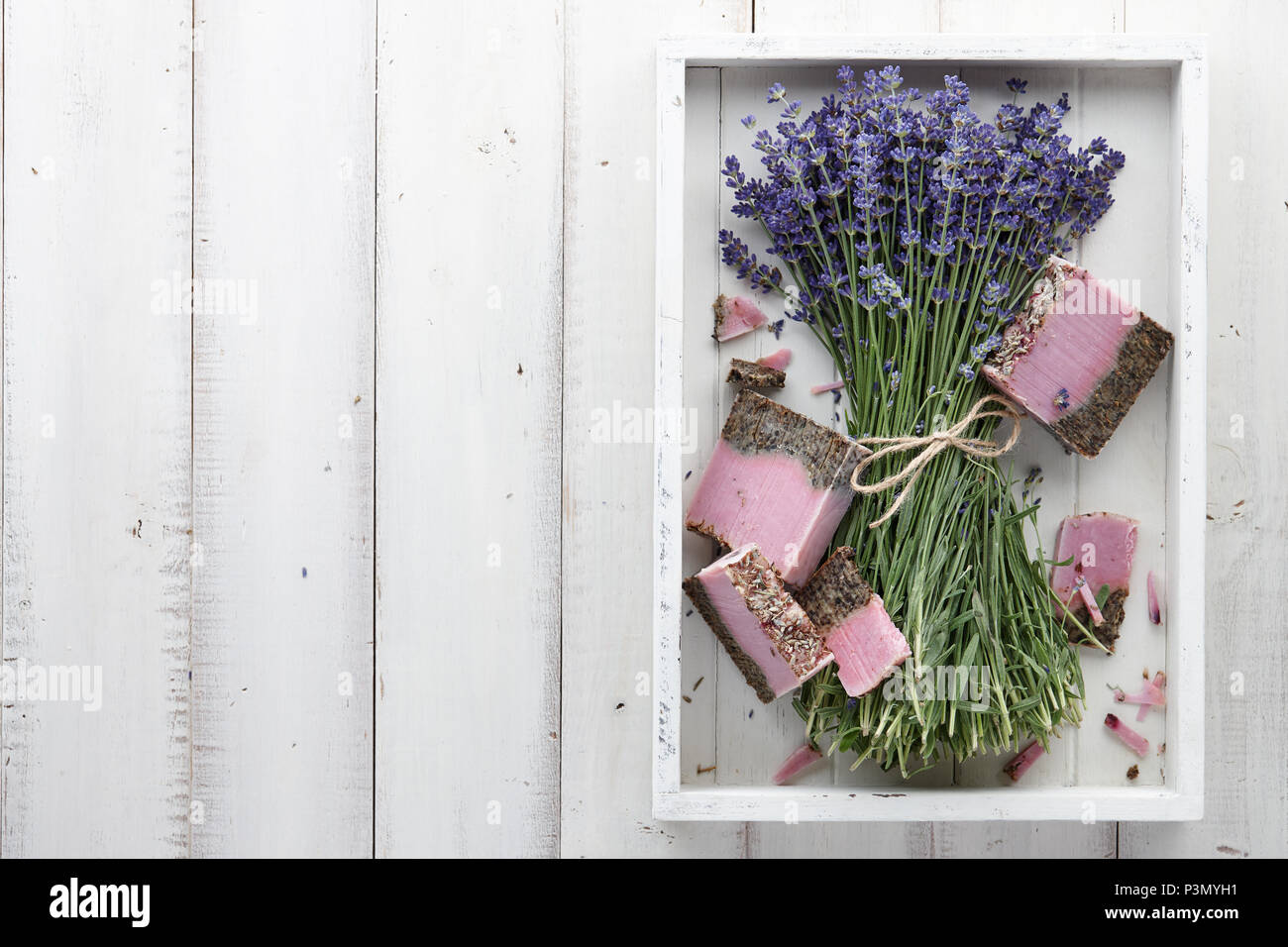 Lavender soap and beautiful flowers in white box Stock Photo