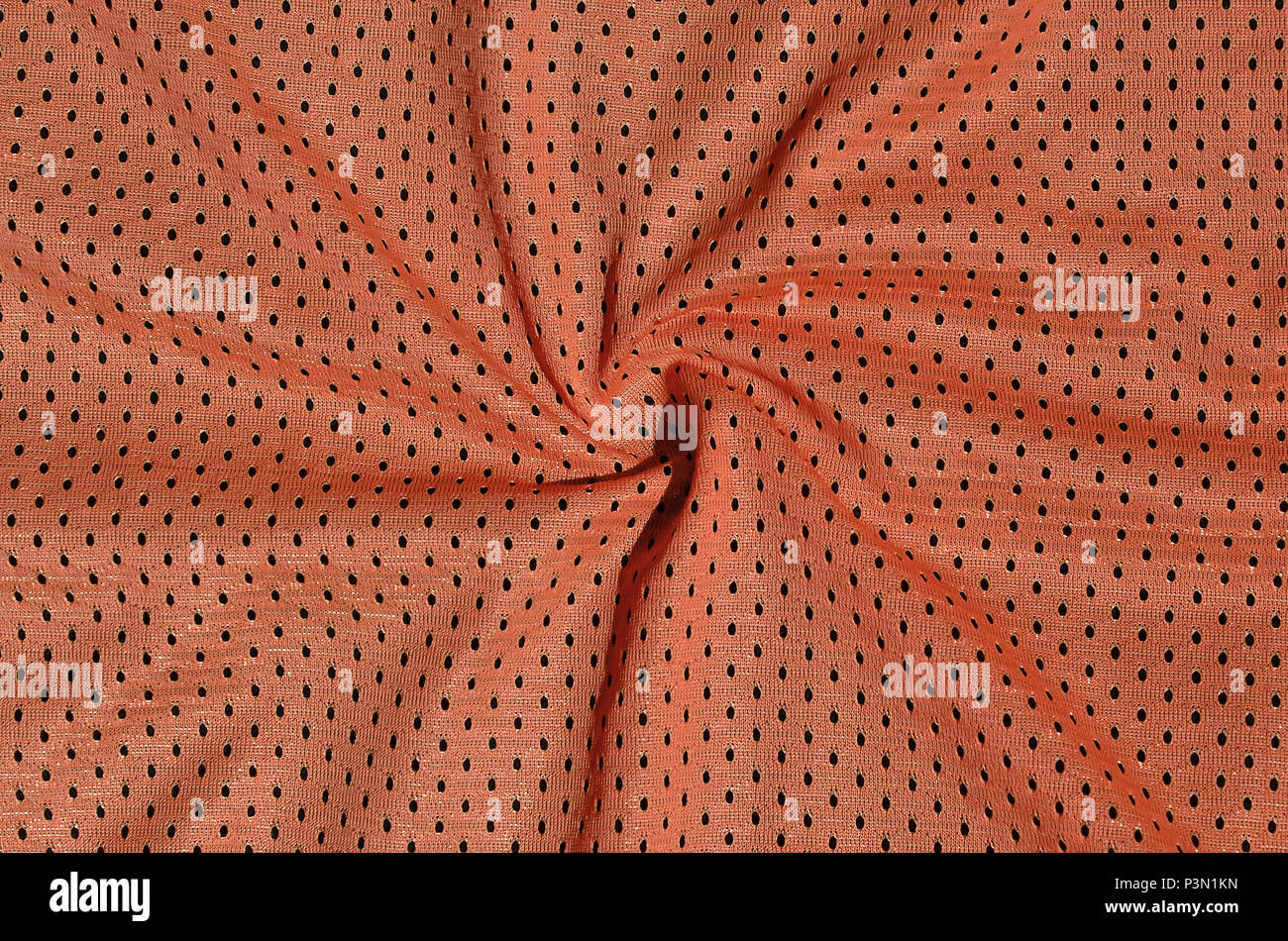 Texture of sportswear made of polyester fiber. Outerwear for sports training has a mesh texture of stretchable nylon fabric - Stock Image