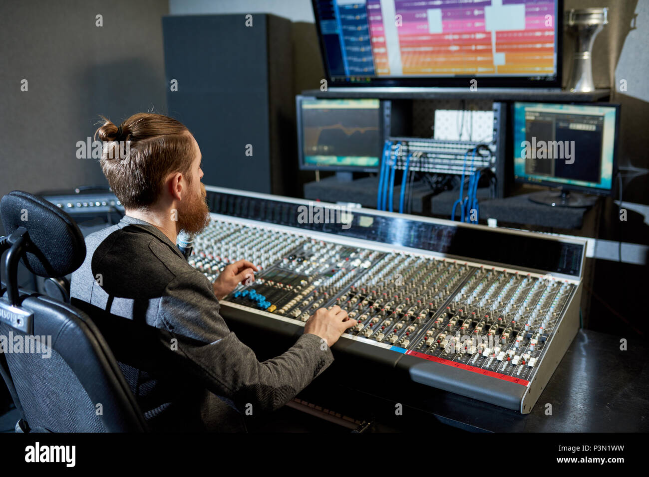 Man mixing and creating music - Stock Image
