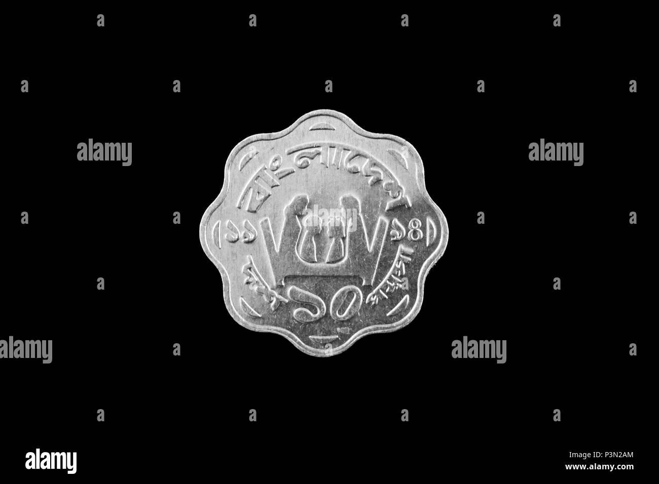 Bangladeshi 10 Poisha steel coin close up isolated on a black background - Stock Image