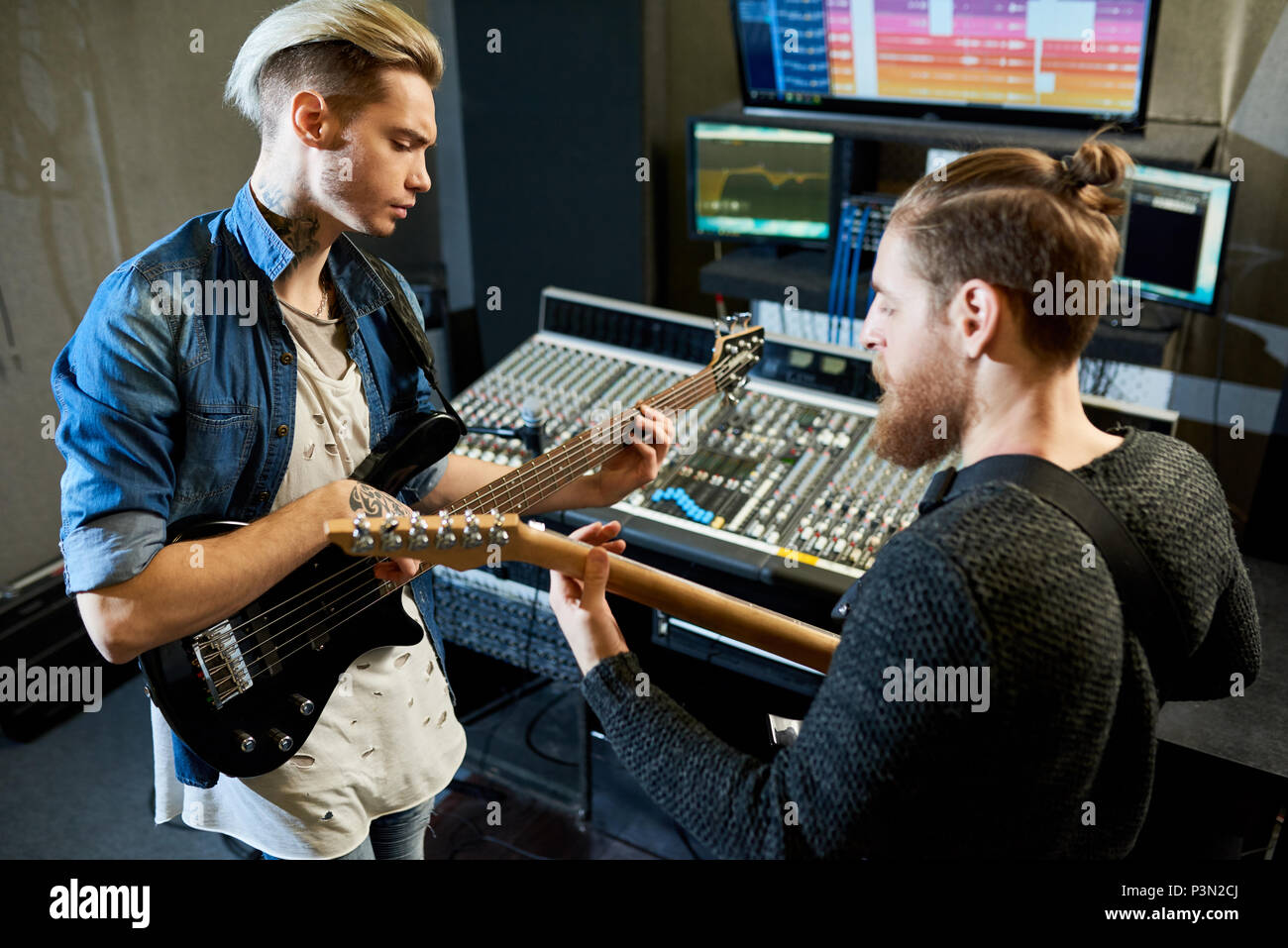 Coworking musicians in recording studio - Stock Image