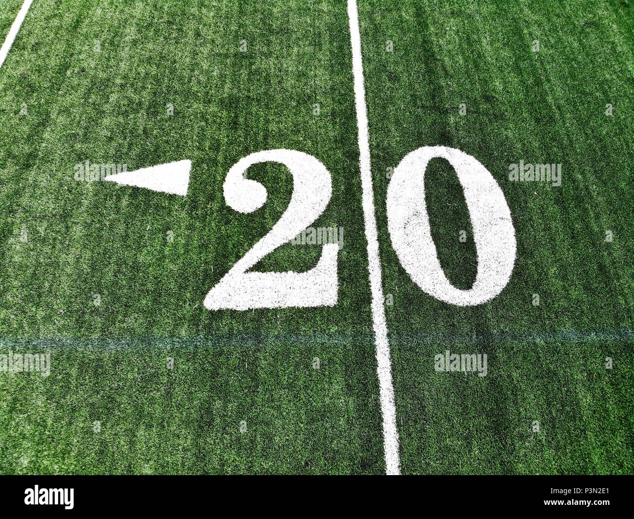 20 yard chalk mark on an green American football field taken from an aerial drone - Stock Image