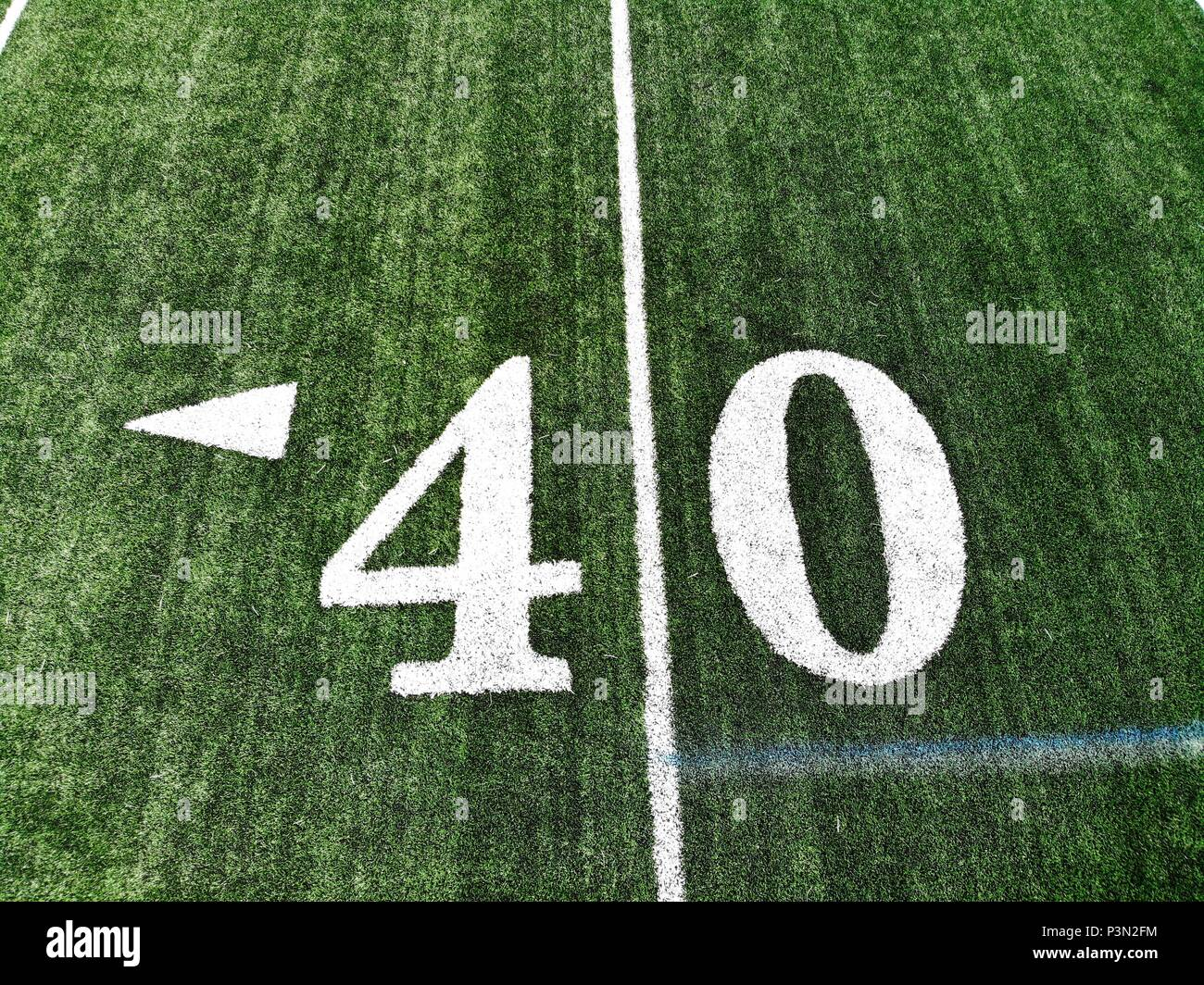 40 yard chalk mark on an green American football field taken from an aerial drone - Stock Image