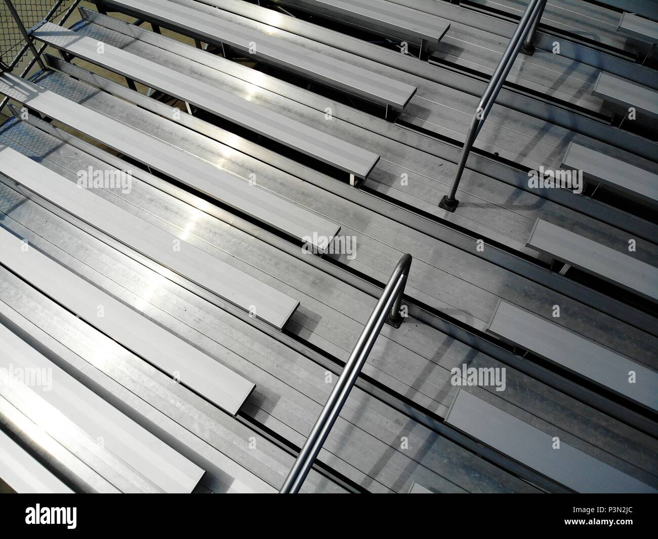 Aerial drone shot of metal bleachers at a sports stadium - Stock Image