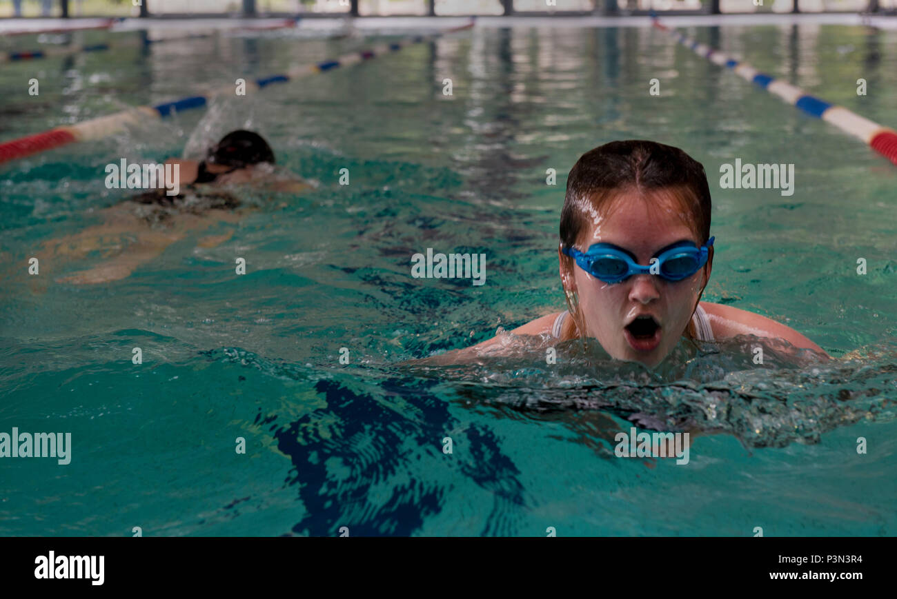 365e21ebdd1 A student in the Ramstein Aquatic Center Lifeguard Course swims as a  prerequisite for the course ...
