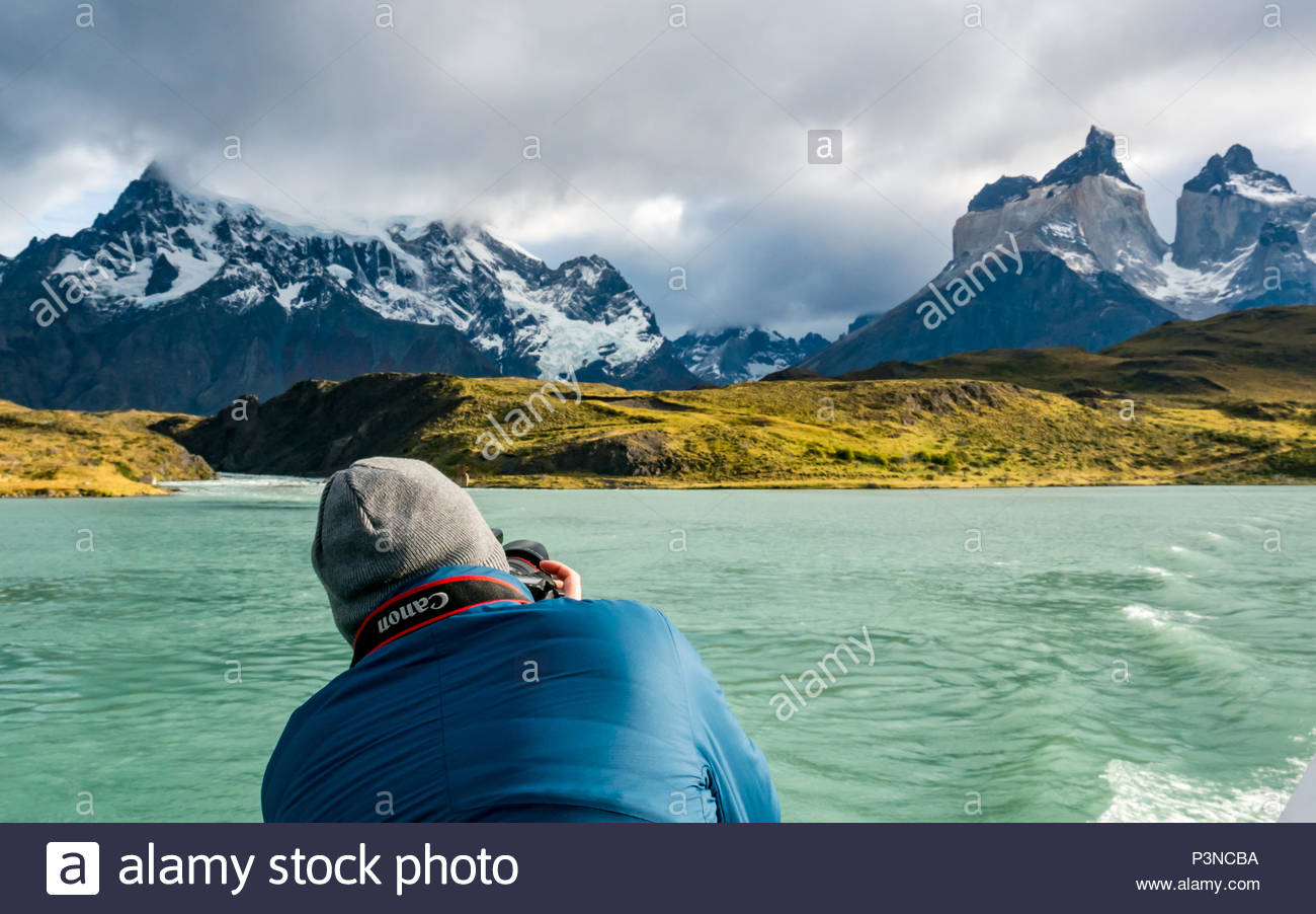Professional photographer taking photo of Paine Horns with Canon Eos 6D camera, Lake Pehoe, Torres del Paine National Park, Patagonia, Chile - Stock Image