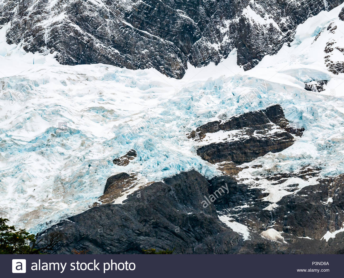 Zoomed view of crevices of blue glacier ice in French Valley, Torres del Paine National Park, Patagonia, Chile, South America Stock Photo