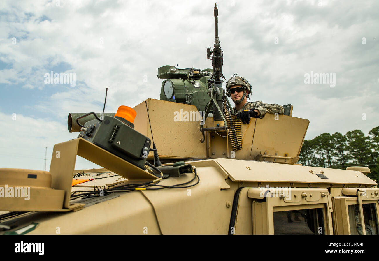 A New York Army National Guard Soldier assigned to Co. B., 1st Battalion, 69th Infantry, New York City, mans a humvee's turret equipped with a Javelin anti-tank missile and an M240 machine gun as the unit stages a convoy at the Joint Readiness Training Center, Ft. Polk, La., Saturday, July 16. The infantryman joined more than 5,000 Soldiers from other state Army National Guard units, active Army and Army Reserve troops as part of the 27th Infantry Brigade Combat Team task force.  The Soldiers will hone their skills and practice integrating combat operations ranging from infantry troops engagin Stock Photo
