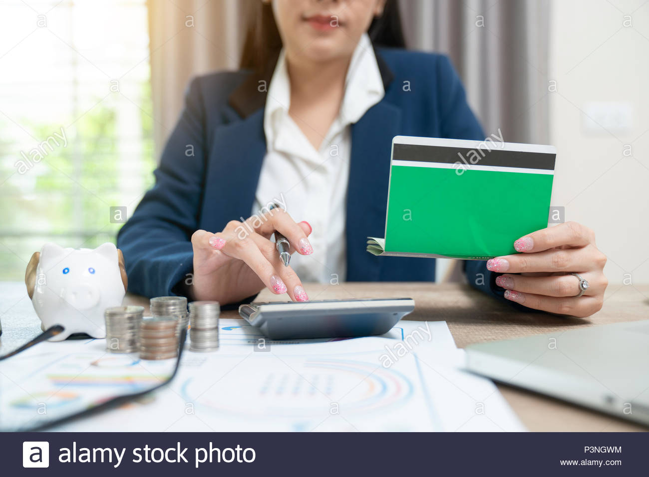 Accountant calculating the Saving Account Book and Statement of financial statements at home - Stock Image