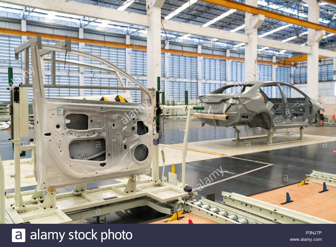 Workers assembles cars at Fiat Cars Serbia factory - Stock Image