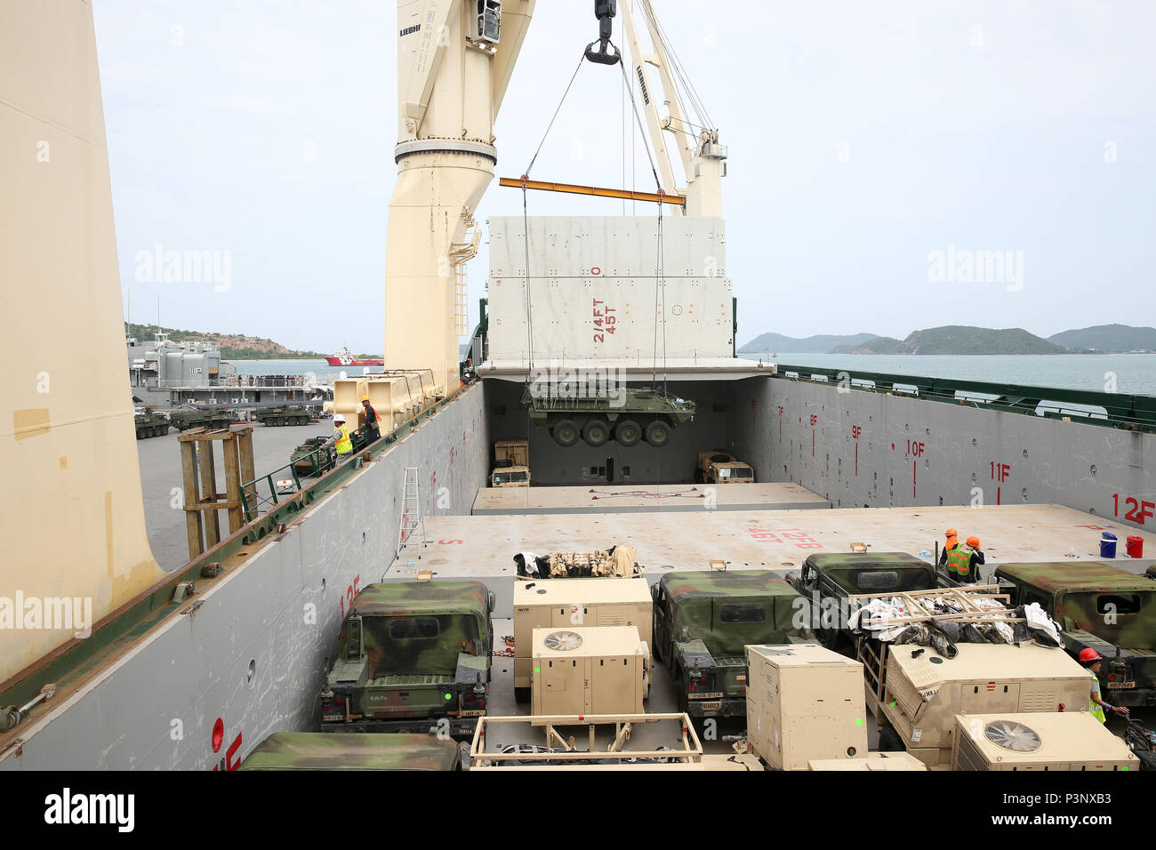 160712-N-IX266-002 SATTAHIP, Thailand—An M1126 Stryker is lowered into general purpose, heavy lift ship MV OCEAN GLORY during a backload of equipment at Chuk Samet, here, from exercise Hanuman Guardian, July 12. Military Sealift Command's contracted voyage-charter MV OCEAN GLORY recently conducted a backload of about 250 items in Thailand as part of U.S. Army Pacific's mobility operation PACIFIC PATHWAYS 16-2. (U.S. Navy photo by Grady T. Fontana/Released) - Stock Image