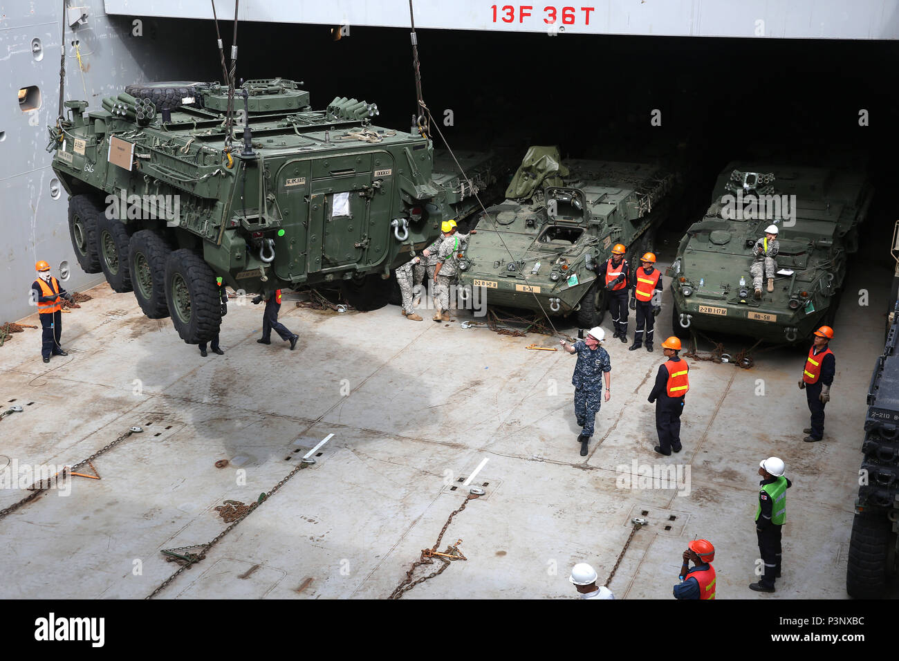 160712-N-IX266-004 SATTAHIP, Thailand—An M1126 Stryker is lowered into general purpose, heavy lift ship MV OCEAN GLORY during a backload of equipment at Chuk Samet, here, from exercise Hanuman Guardian, July 12. Military Sealift Command's contracted voyage-charter MV OCEAN GLORY recently conducted a backload of about 250 items in Thailand as part of U.S. Army Pacific's mobility operation PACIFIC PATHWAYS 16-2. (U.S. Navy photo by Grady T. Fontana/Released) - Stock Image