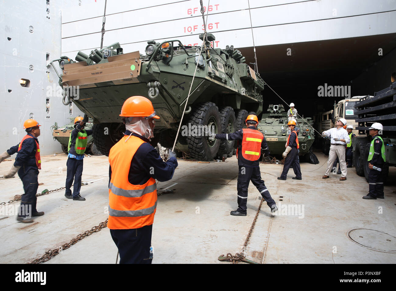 160712-N-IX266-006 SATTAHIP, Thailand—An M1126 Stryker is lowered into general purpose, heavy lift ship MV OCEAN GLORY during a backload of equipment at Chuk Samet, here, from exercise Hanuman Guardian, July 12. Military Sealift Command's contracted voyage-charter MV OCEAN GLORY recently conducted a backload of about 250 items in Thailand as part of U.S. Army Pacific's mobility operation PACIFIC PATHWAYS 16-2. (U.S. Navy photo by Grady T. Fontana/Released) - Stock Image