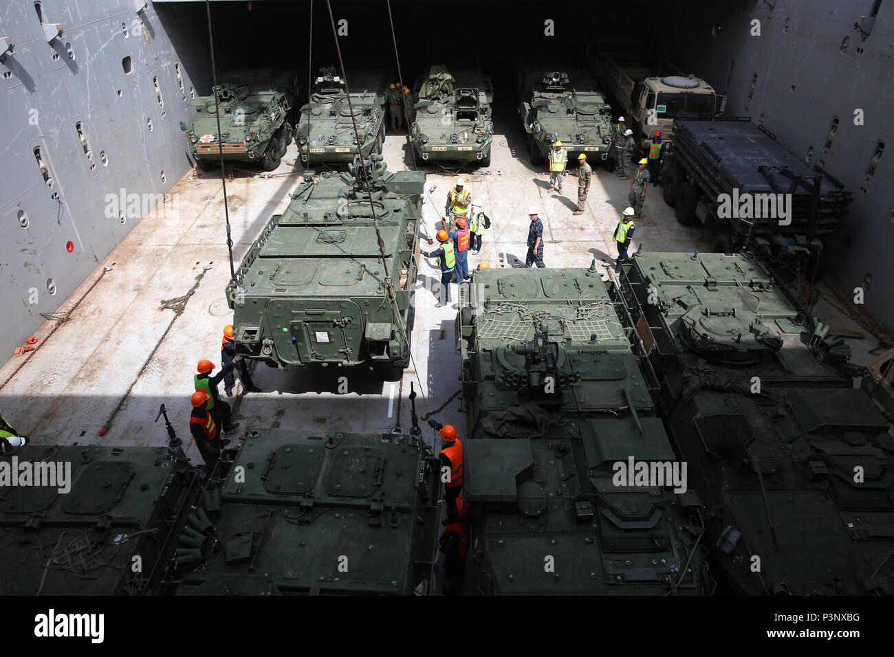 160712-N-IX266-009 SATTAHIP, Thailand—An M1126 Stryker is staged in the cargo deck of general purpose, heavy lift ship MV OCEAN GLORY during a backload of equipment at Chuk Samet, here, from exercise Hanuman Guardian, July 12. Military Sealift Command's contracted voyage-charter MV OCEAN GLORY recently conducted a backload of about 250 items in Thailand as part of U.S. Army Pacific's mobility operation PACIFIC PATHWAYS 16-2. (U.S. Navy photo by Grady T. Fontana/Released) - Stock Image