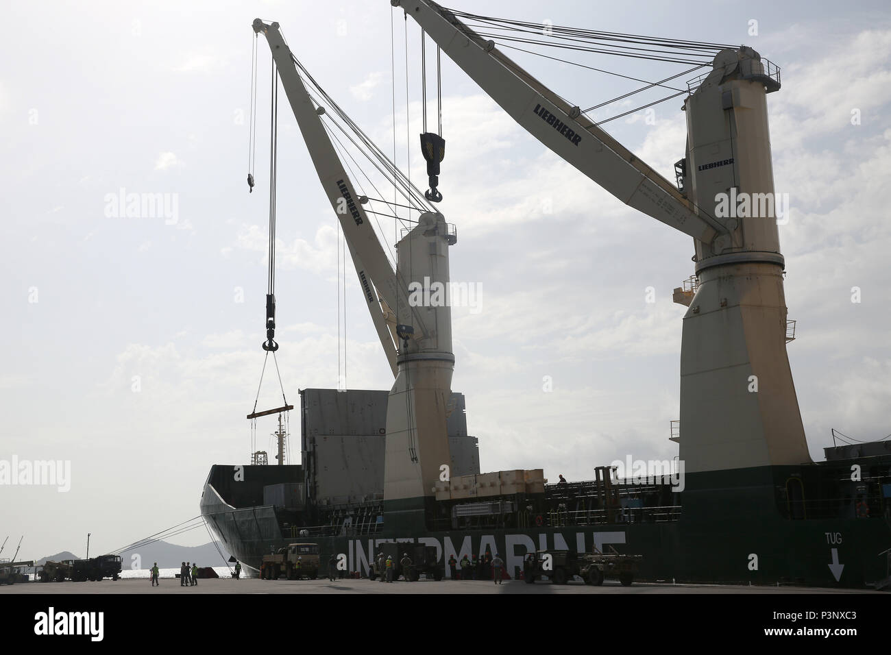 160712-N-IX266-015 SATTAHIP, Thailand—A group of military vehicles is staged portside of the general purpose, heavy lift ship MV OCEAN GLORY during a backload of equipment at Chuk Samet, here, from exercise Hanuman Guardian, July 12. Military Sealift Command's contracted voyage-charter MV OCEAN GLORY recently conducted a backload of about 250 items in Thailand as part of U.S. Army Pacific's mobility operation PACIFIC PATHWAYS 16-2. (U.S. Navy photo by Grady T. Fontana/Released) - Stock Image