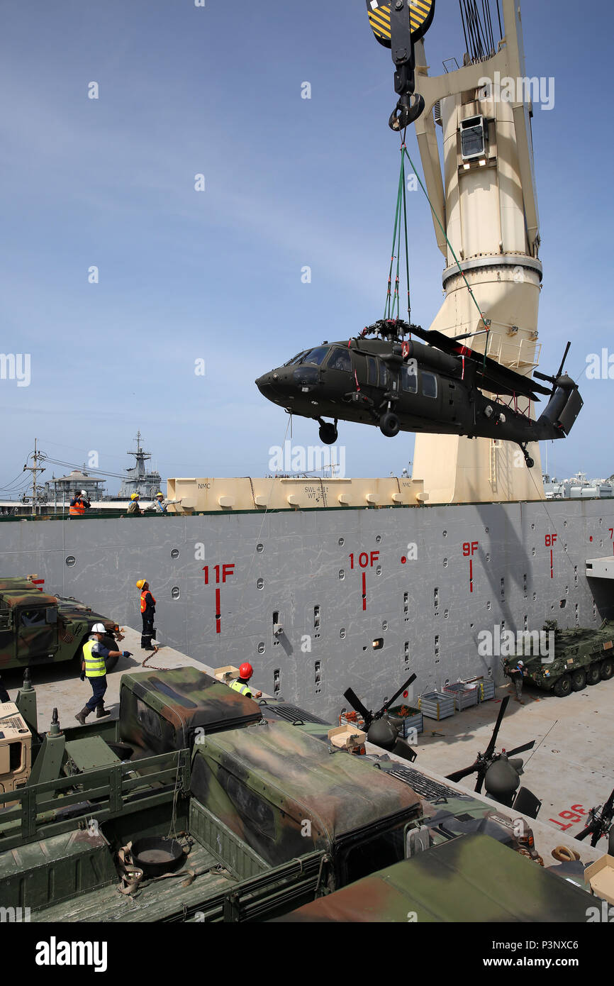 160712-N-IX266-021 SATTAHIP, Thailand—A UH-60 helicopter is lowered into general purpose, heavy lift ship MV OCEAN GLORY during a backload of equipment at Chuk Samet, here, from exercise Hanuman Guardian, July 12. Military Sealift Command's contracted voyage-charter MV OCEAN GLORY recently conducted a backload of about 250 items in Thailand as part of U.S. Army Pacific's mobility operation PACIFIC PATHWAYS 16-2. (U.S. Navy photo by Grady T. Fontana/Released) - Stock Image