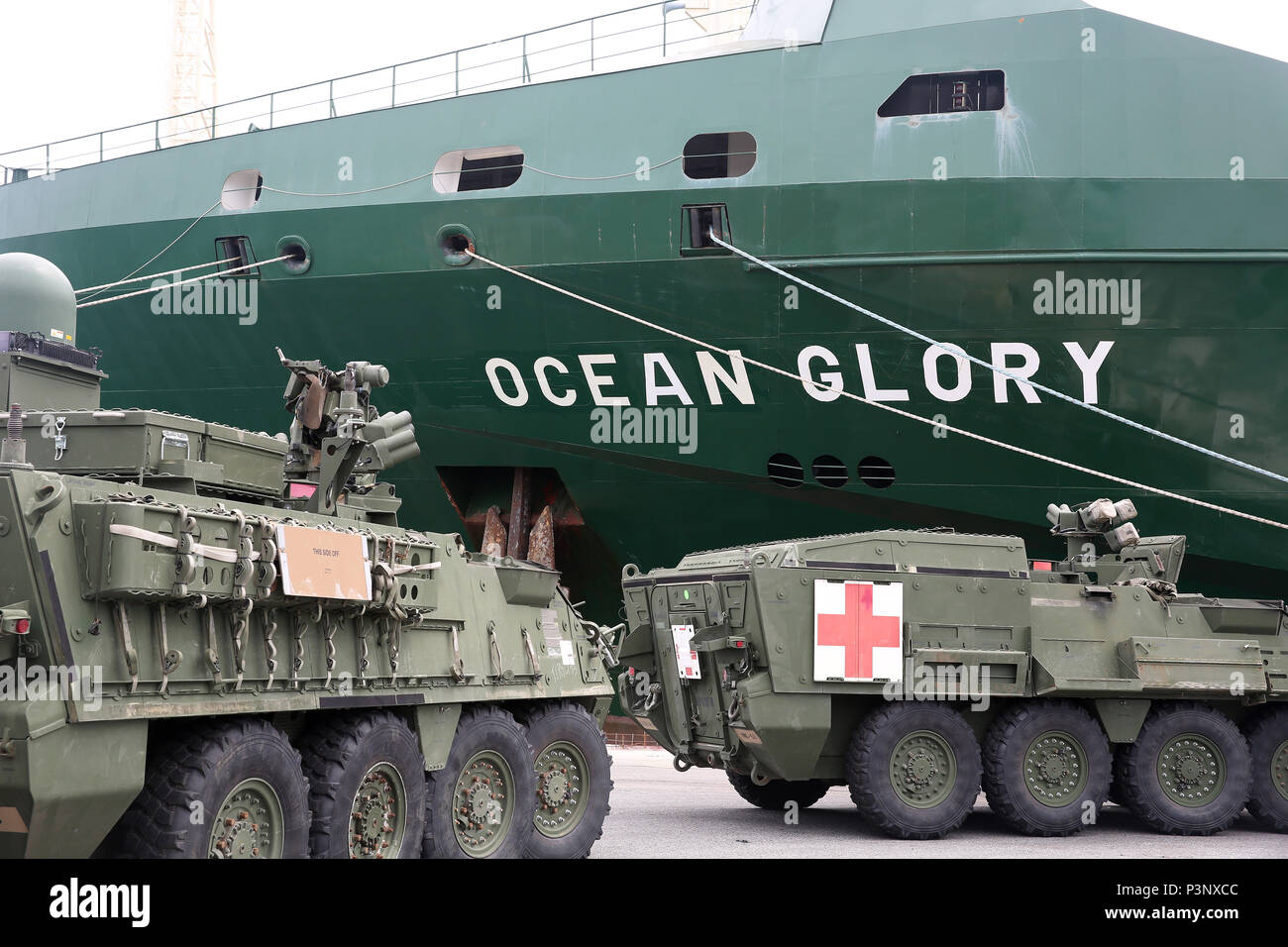 160712-N-IX266-014 SATTAHIP, Thailand—A line of M1126/M1133 Strykers is staged portside of the general purpose, heavy lift ship MV OCEAN GLORY during a backload of equipment at Chuk Samet, here, from exercise Hanuman Guardian, July 12. Military Sealift Command's contracted voyage-charter MV OCEAN GLORY recently conducted a backload of about 250 items in Thailand as part of U.S. Army Pacific's mobility operation PACIFIC PATHWAYS 16-2. (U.S. Navy photo by Grady T. Fontana/Released) - Stock Image