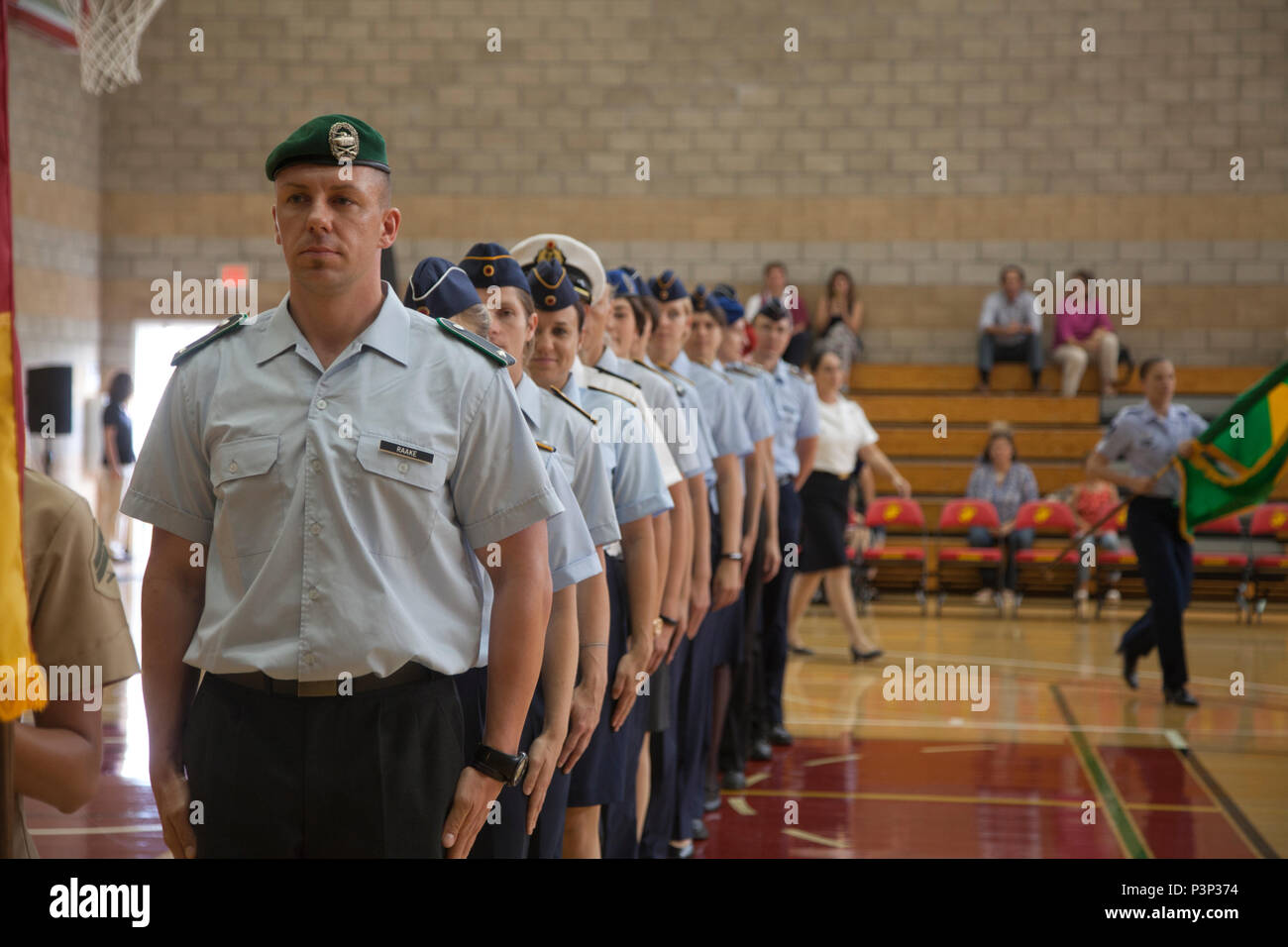 The team representing Germany in the World Military Women's Basketball Championship stand at attention during the 2016 Conseil International Du Sport Militaire (CISM) opening ceremony on Camp Pendleton, Calif., July 25, 2016. CISM championships are hosted around the world and provide an avenue for the United States to project the positive image with valuable military-to-military engagement through sports. (U.S. Marine Corps photo by Cpl. Tyler S. Dietrich) - Stock Image